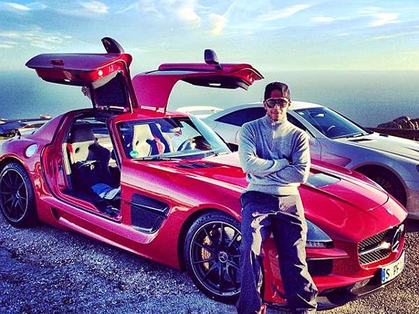 1a1299b26ea Lewis Hamilton Poses With His Mercedes-Benz sports cars - DriveSpark