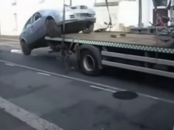 Man Jumps Car Off Flatbed Avoid Towing Charges