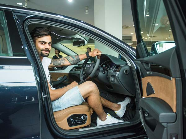 viratl kohli with his audi a8 l