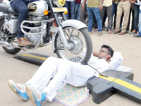 100 royal enfield run over stomach youth guinness record