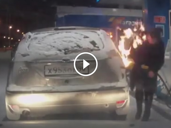Flaming Idiot — Woman Ignites Car's Frozen Fuel Cap At Petrol Pump