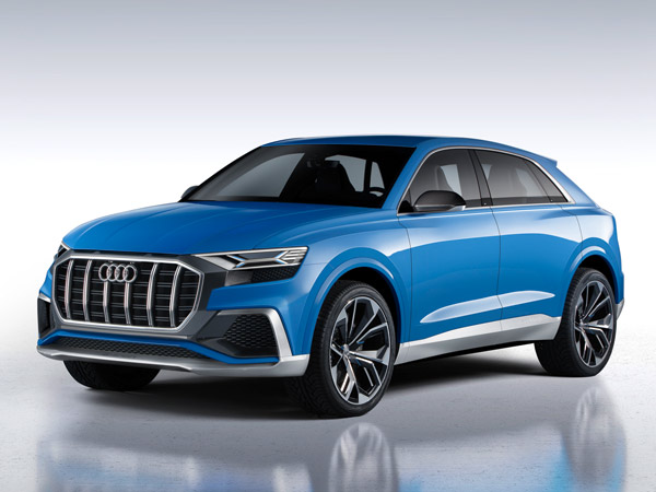 The Audi Q8 sits on 23-inch Y-spoke alloy wheels that are shod with ...