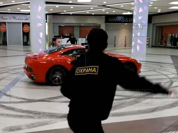 Car Drives Through Russian Mall