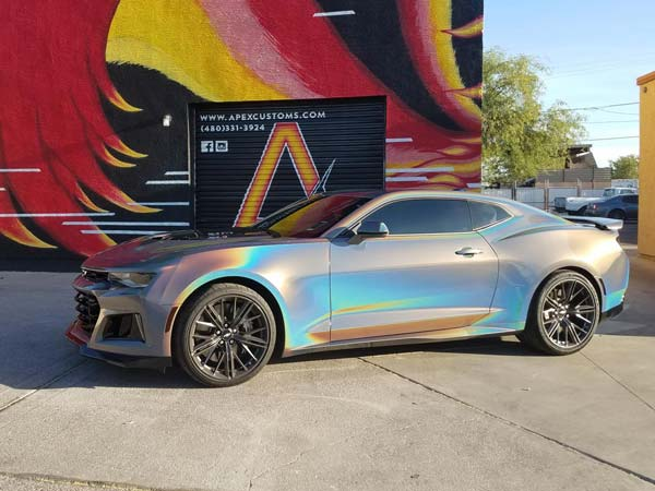 Car Wraps Cost >> Camaro ZL1 Owner Wraps His Car With 3M Gloss Flip Psychedelic Vinyl Film - DriveSpark News