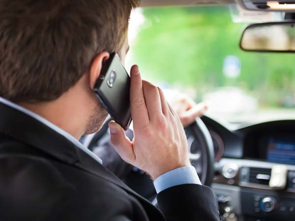 Cell phones dangerous while driving essay