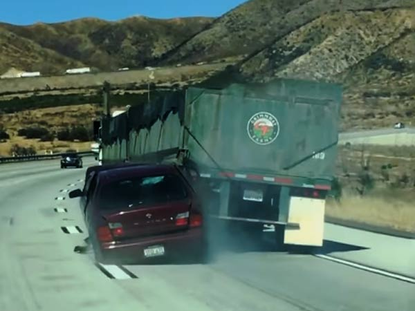 Watch An Unaware Truck Driver Dragging A Car And Its Driver After An Accident