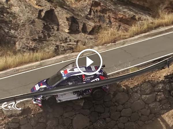 Guardrail saves rally car from tumbling down the cliff