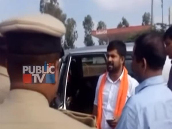 Karnataka MP Driving Innova Crysta Breaks Barricade And Almost Runs Over A Cop