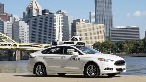 Self-driving Ubers on hold after pedestrian death