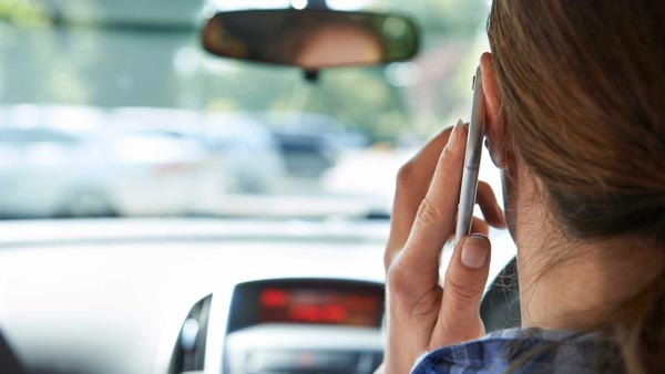 Talking On Mobile Phone While Driving/Riding Will Get Your Licence Cancelled