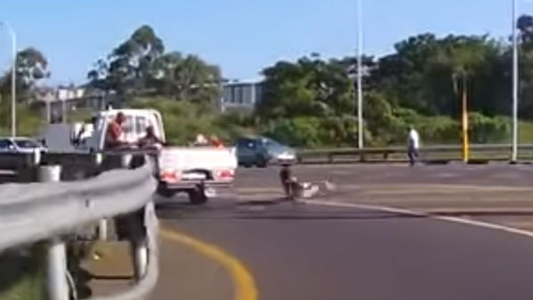 Video: Man Falls Off LCV's Cargo Bay On A Highway; Escapes Unhurt