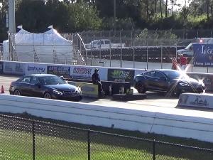 Video: Biturbo Vs Dual Electric Motor Drag Race