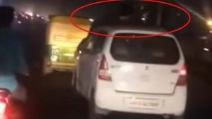 Road Rage In India: Video Of A Man On Top Of A Running Car Becomes Viral!