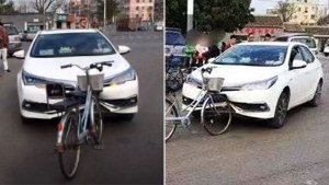 An Accident Video From China Leaves Everyone Puzzled After A Cycle Heavily Damages A Car's Bumper