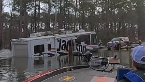 Video: Dog Accidentally Puts Vehicle Into Reverse Gear; Drives Into Lake