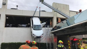 Lexus NX Dangles Precariously Out Of Second Storey Parking Garage With Driver Inside