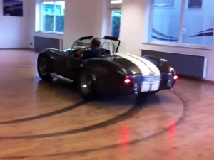 Shelby Cobra Performing Burnouts In An Apartment