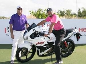 Tiger Woods Checks Out Hero Karizma ZMR Motorcycle