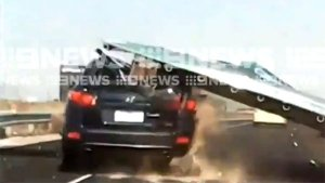 A Massive Sign Board Falls On Top Of A Moving Car — One More Reason To Fear Highway Trips