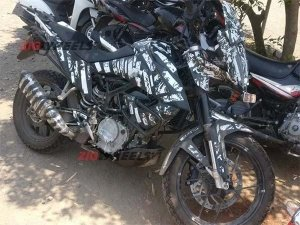 KTM 390 Adventure Spotted Testing Again; Latest Spy Pics Reveal Luggage Mounts & New Screen